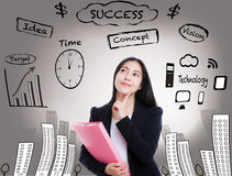 Young business woman has many ideas on business background. Stock Photos