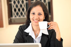 Young business woman having coffee Royalty Free Stock Image