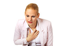 Young business woman having heart disease Stock Photo
