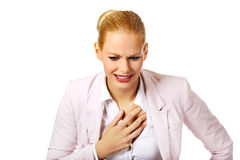 Young business woman having heart disease Royalty Free Stock Photo