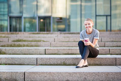 Young business woman having her coffee break Stock Image