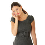 Young business woman with headache Royalty Free Stock Image