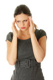 Young business woman with headache Stock Photography