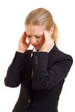 Young business woman with headache. On a white background royalty free stock photography