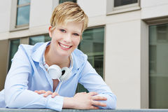 Young business woman with headphones Stock Images
