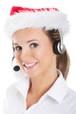 Young business woman with headphose, microphone in santa hat. Stock Images