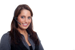 A young business woman with a headset. A woman wearing a business dress and having a headset Stock Photo