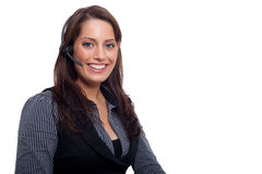 A young business woman with a headset. A woman wearing a business dress and having a headset Royalty Free Stock Photos
