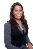 A young business woman with a headset. A young woman talking to somebody with a headset Stock Images