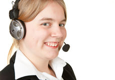 Young business woman with headset Royalty Free Stock Photo