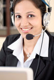 Young business woman with headset Stock Photography