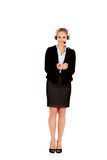 Young business woman in headset holding copyspace or something Royalty Free Stock Photo