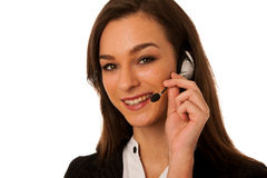 Young business woman with headset isolated over white background Royalty Free Stock Photo