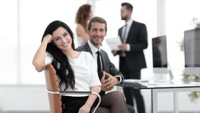 Young business woman and her colleagues Royalty Free Stock Photography
