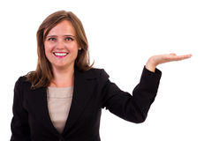 Young business woman with her hand outstretched. As though she is presenting something Stock Photo