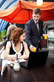 Young business woman and her partner on lunch Stock Image