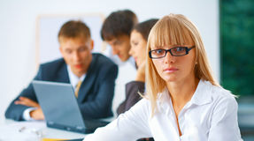 Young business woman with her team Royalty Free Stock Image
