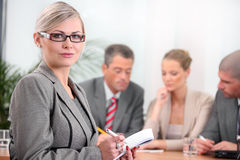 Young business woman with her team. Business people in the office Royalty Free Stock Image