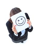 young business woman hiding behind a smiley face Stock Photos