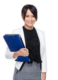 Young business woman hold laptop computer and clipboard Stock Photo