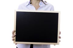 Young business woman holding a blackboard Stock Photo