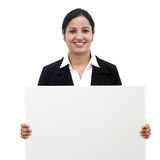 Young business woman holding blank signboard Royalty Free Stock Photos