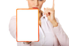 Young business woman holding a board with ban Stock Photo