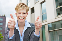 Young business woman holding both thumbs up Stock Photos
