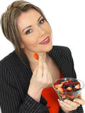 Young Business Woman Holding a Bowl of Fresh Fruit Berries Royalty Free Stock Photos