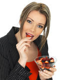 Young Business Woman Holding a Bowl of Fresh Fruit Berries Stock Image