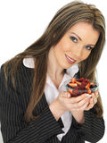 Young Business Woman Holding a Bowl of Fresh Mixed Berries Royalty Free Stock Photo