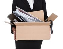 Young Business Woman Holding A Box Of Documents Stock Photo