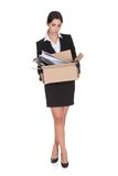 Young Business Woman Holding A Box Of Documents stock photos