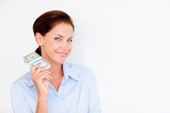 Young business woman holding cash Royalty Free Stock Photos