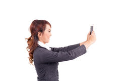 Young business woman holding cellphone Royalty Free Stock Photo
