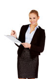 Young business woman holding clipboard Stock Photo