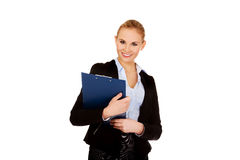 Young business woman holding clipboard Stock Image