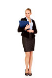 Young business woman holding clipboard Stock Photography