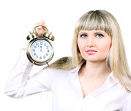 Young business woman holding clock Royalty Free Stock Photography