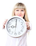Young business woman holding clock Royalty Free Stock Photos