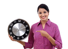 Young business woman holding clock in hand Stock Photo