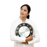 Young business woman holding clock Stock Image