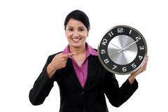 Young business woman holding clock in hands Royalty Free Stock Photo