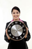 Young business woman holding clock in hands Stock Photo