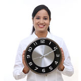 Young business woman holding clock in hands Royalty Free Stock Photography