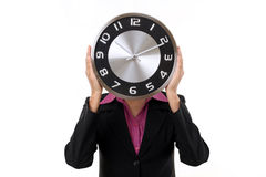 Young business woman holding clock in hands Stock Image