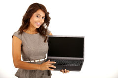 Young business woman holding a computer. Royalty Free Stock Photo