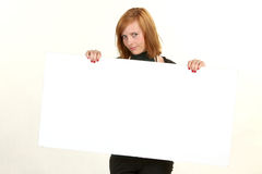 Young business woman holding empty white board for your sign Royalty Free Stock Images
