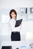 Young business woman holding folder in office Royalty Free Stock Photos