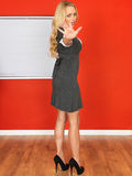 Young Business Woman Holding Hand Out in Stop Position Royalty Free Stock Images